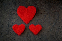 Greeting card for valentine's day handmade one big and two small hearts from felt white and red colour Royalty Free Stock Image