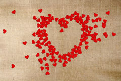 Greeting card Valentines day. Paper hearts, scattered on canvas Royalty Free Stock Image