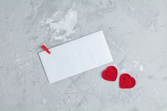 Greeting card for Valentines Day. Valentines Day greeting card with two handmade hearts and paper envelope for you text on gray concrete surface, top view, flat royalty free stock images