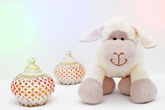 Greeting card on white background. Eid Al Adha sacrifice festival, Islamic Arabic candle and sheep.  stock image