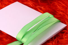 Greeting card with white paper and green bow Royalty Free Stock Photography