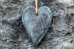 Greeting card wooden heart with rocky background Stock Image