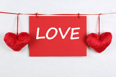 Greeting card with word love on Valentine's or mother's day with Stock Photo