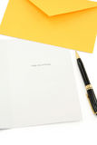 Greeting card and yellow envelope Stock Photo