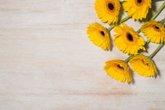 Greeting card with yellow flowers over wooden background. Top vi Stock Photo