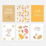 Greeting cards with autumn elements. Vector set of greeting cards with autumn elements and lettering. Happy September, hello autumn, fall in love, enjoy Stock Illustration