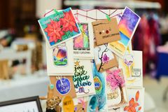 Greeting cards on display at craft market. Custom made greeting cards handmade at craft market stock photography
