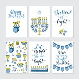 Greeting cards for Hanukkah. Vector set of greeting cards for Hanukkah with holiday lettering and design elements. Menorah, candles, donuts, garland, bow Royalty Free Stock Photography