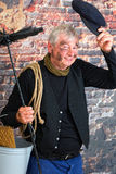 Greeting chimney sweep. Charming chimney sweep greeting with his cap Royalty Free Stock Photography