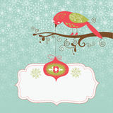 Greeting Christmas card. Bird with the toy Stock Photography