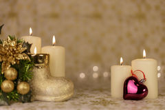 Greeting Christmas card with burning candles and ornaments. Greeting Christmas card with burning candles, golden decoration and lights Royalty Free Stock Images