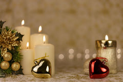 Greeting Christmas card with burning candles and ornaments. Greeting Christmas card with burning candles, golden decoration and lights Royalty Free Stock Photography