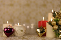 Greeting Christmas card with burning candles and ornaments. Greeting Christmas card with burning candles, golden decoration and lights Stock Images