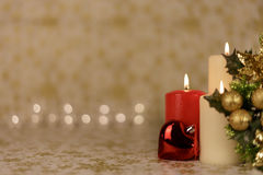 Greeting Christmas card with burning candles and ornaments. Greeting Christmas card with burning candles, golden decoration and lights Stock Photos