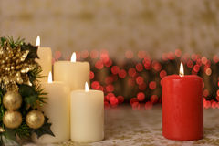 Greeting Christmas card with burning candles and ornaments. Greeting Christmas card with burning candles, golden decoration and lights Royalty Free Stock Image