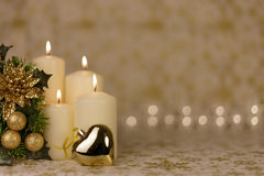 Greeting Christmas card with burning candles and ornaments. Greeting Christmas card with burning candles, golden decoration and lights Stock Image