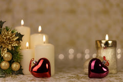 Greeting Christmas card with burning candles and ornaments. Greeting Christmas card with burning candles, golden decoration and lights Stock Photography
