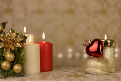 Greeting Christmas card with burning candles and ornaments. Greeting Christmas card with burning candles, golden decoration and lights Stock Photo