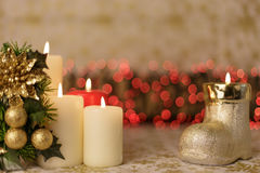 Greeting Christmas card with burning candles and ornaments. Greeting Christmas card with burning candles, golden decoration and lights Royalty Free Stock Photo