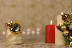 Greeting Christmas card with burning candles and ornaments. Greeting Christmas card with burning candles, golden decoration and lights Royalty Free Stock Photos