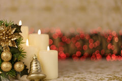 Greeting Christmas card with burning candles and ornaments. Greeting Christmas card with burning candles, golden decoration and red lights Royalty Free Stock Photos