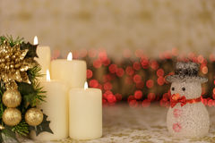 Greeting Christmas card with burning candles and ornaments. Greeting Christmas card with burning candles, golden decoration and red lights Royalty Free Stock Photography