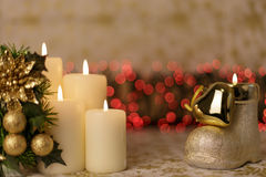 Greeting Christmas card with burning candles and ornaments. Greeting Christmas card with burning candles, golden decoration and red lights Stock Photography