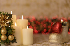 Greeting Christmas card with burning candles and ornaments. Greeting Christmas card with burning candles, golden decoration and red lights Stock Images