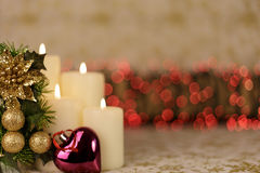 Greeting Christmas card with burning candles and ornaments. Greeting Christmas card with burning candles, golden decoration and red lights Stock Photo