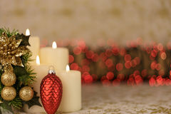 Greeting Christmas card with burning candles and ornaments. Greeting Christmas card with burning candles, golden decoration and redlights Royalty Free Stock Photo