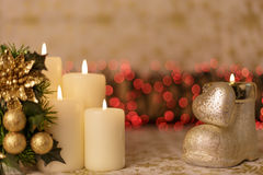 Greeting Christmas card with burning candles and ornaments. Greeting Christmas card with burning candles, golden decoration and redlights Royalty Free Stock Image