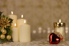 Greeting Christmas card with burning candles and ornaments. Greeting Christmas card with burning candles, golden decoration and yellow lights Stock Photos