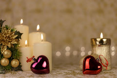Greeting Christmas card with burning candles and ornaments. Greeting Christmas card with burning candles, golden decoration and yellow lights Royalty Free Stock Images