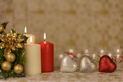 Greeting Christmas card with burning candles and ornaments. Greeting Christmas card with burning candles, golden decoration and yellow lights Stock Photography