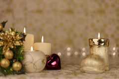 Greeting Christmas card with burning candles and ornaments. Greeting Christmas card with burning candles, golden decoration and yellow lights Royalty Free Stock Photos