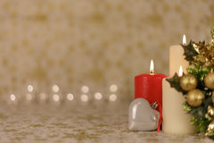 Greeting Christmas card with burning candles and ornaments. Greeting Christmas card with burning candles, golden decoration and yellow lights Stock Images
