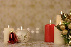 Greeting Christmas card with burning candles and ornaments. Greeting Christmas card with burning candles, golden decoration and yellow lights Royalty Free Stock Photography
