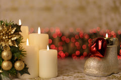 Greeting Christmas card with burning candles and ornaments. Greeting Christmas card with burning candles, golden decoration and yellow lights Royalty Free Stock Image