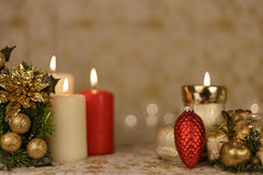 Greeting Christmas card with burning candles and ornaments. Greeting Christmas card with burning candles, golden decoration and yellow lights Royalty Free Stock Photo