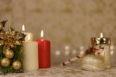 Greeting Christmas card with burning candles and ornaments. Greeting Christmas card with burning candles, golden decoration and yellow lights Stock Image