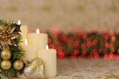 Greeting Christmas card with burning candles and ornaments. Greeting Christmas card with burning candles, red decoration and yellow lights Stock Images