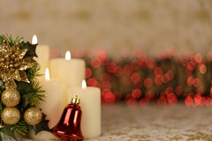 Greeting Christmas card with burning candles and ornaments. Greeting Christmas card with burning candles, red decoration and yellow lights Royalty Free Stock Photography