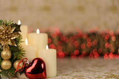 Greeting Christmas card with burning candles and red decoration Royalty Free Stock Image