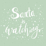 Greeting Christmas card. Hand drawn lettering Santa is watching. Vector christmas message design Royalty Free Stock Images