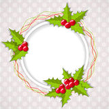 Greeting Christmas card with holly. Royalty Free Stock Images