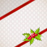 Greeting Christmas card with holly. Stock Photos