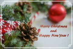 Greeting Christmas card with the inscription in a frame,photo Royalty Free Stock Images
