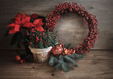 Greeting Christmas card with red and green decorations on wood Royalty Free Stock Images