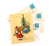 Greeting Christmas Cards. GDR - CIRCA 1956: Greeting Christmas Card printed in the East Germany (GDR) shows Santa Claus and Christmas tree, circa 1956 Stock Photo