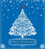 Greeting Christmas retro blue card with paper white applique with cut out paper fir tree and snowflakes. Greeting Christmas retro blue card with paper white Royalty Free Stock Photography
